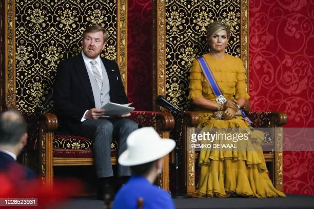 Netherlands King WillemAlexander and Queen Maxima by his side reads the speech from the throne on Budget Day to members of the Senate and House of...