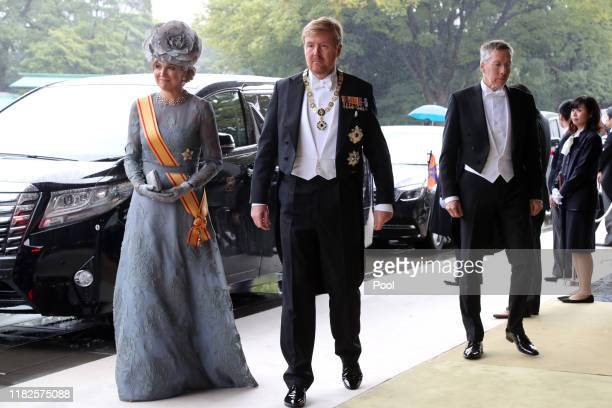 Netherland's King Willem-Alexander, center, and Queen Maxima, left, arrive at the Imperial Palace to attend the proclamation ceremony of Japan's...