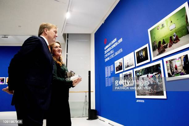 Netherlands King WillemAlexander listens as overall winner Cynthia Boll of the annual Zilveren Camera photojournalism contest speaks about her...