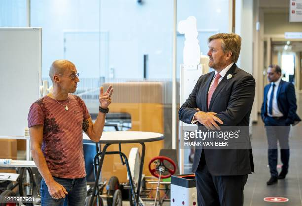 Netherlands' King WillemAlexander listens during a visit to Avans Hogeschool Breda in Breda on June 26 a working visit to the school to investigate...
