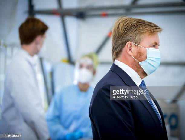 Netherland's King WillemAlexander looks on as he visits a corona test site in Leiderdorp The Netherlands on September 10 2020 In the parking lot of...