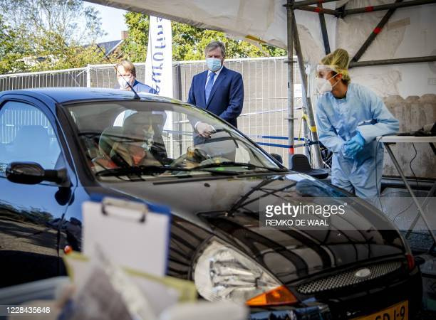 Netherland's King WillemAlexander looks on as he visits a coronavirus testing site in Leiderdorp The Netherlands on September 10 2020 In the parking...