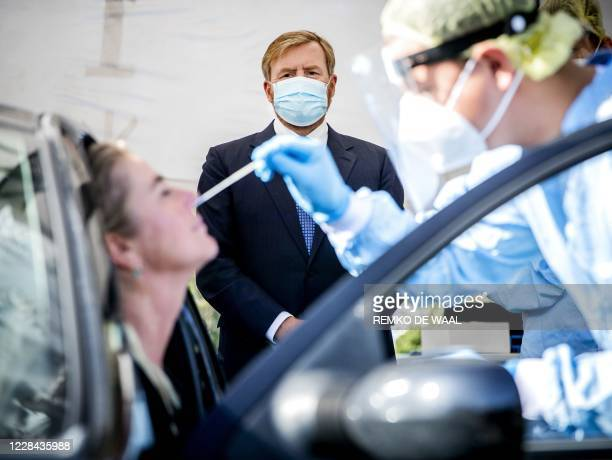 Netherland's King WillemAlexander looks on as he visits a coronavirus test site in Leiderdorp The Netherlands on September 10 2020 In the parking lot...