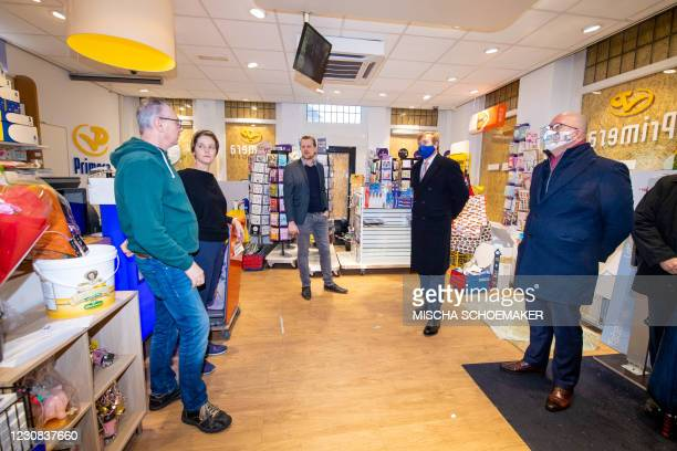 Netherland's King Willem-Alexander meet entrepreneurs as he visits shops in the center of Den Bosch on January 28, 2021 to see the destruction caused...