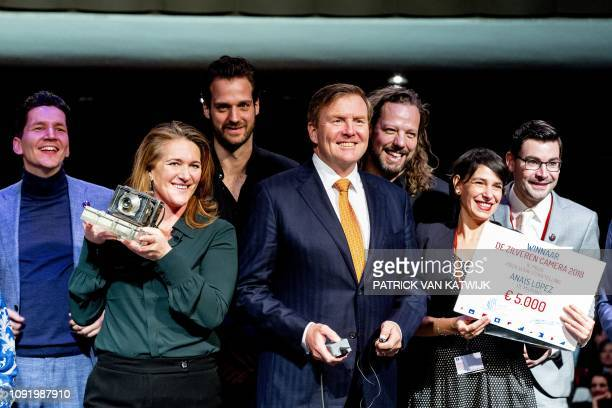 Netherlands King WillemAlexander pushes the button of a remote control camera to take a 'selfie' with the winners of the annual Zilveren Camera...