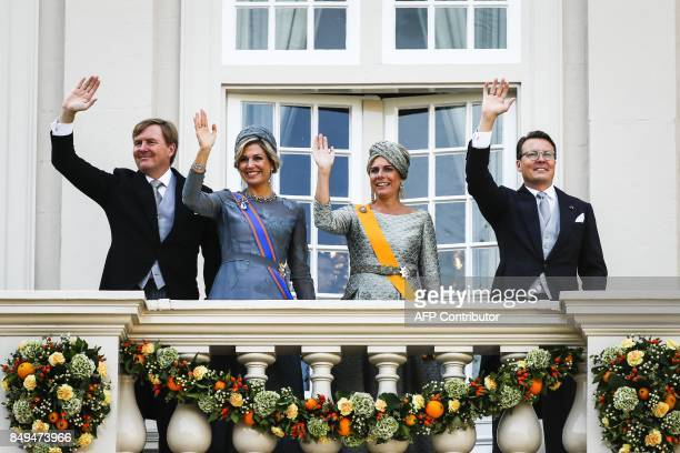Netherland's King WillemAlexander Queen Maxima Princess Laurentien and Prince Constantijn wave to the crowd from the balcony of the Palace Noordeinde...