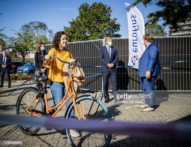 Netherland's King WillemAlexander speaks with an official as he visits coronavirus testing site in Leiderdorp The Netherlands on September 10 2020 In...