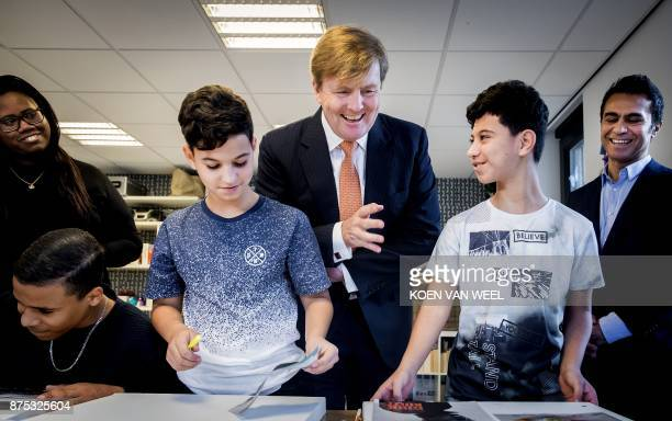 Netherlands' King WillemAlexander visits the 'Weekend Academie' on November 17 2017 in Amsterdam Weekend Academie is a youth support centre that has...