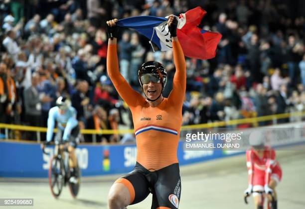 Netherland's Kirsten Wild celebrates after her victory in the women's scratch race at The UCI World Cycling Championships in Apeldoorn on February...