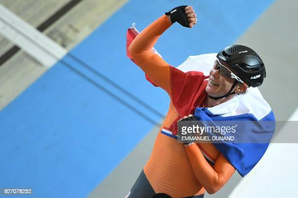 Netherlands Kirsten Wild celebrates winning the women's points race final during the UCI Track Cycling World Championships in Apeldoorn on March 4...
