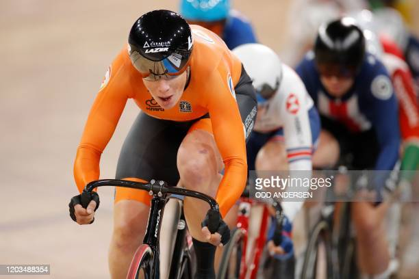 Netherlands' Kirsten Wild competes to win the women's 10 km scratch race final at the UCI track cycling World Championship in Berlin on February 26,...