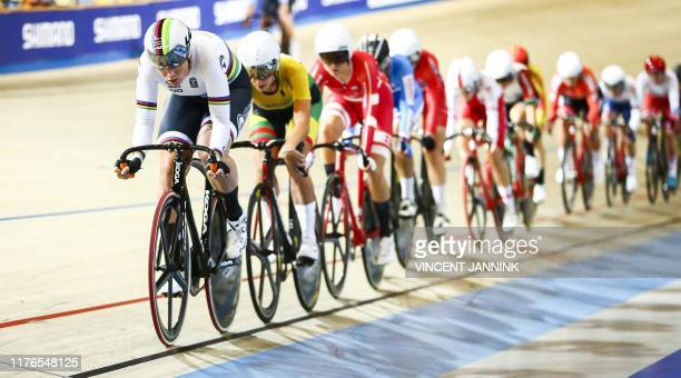 Netherlands' Kirsten Wild leads the pack as she competes in the omnium scratch race at the European Track Cycling Championships in Apeldoorn, on...