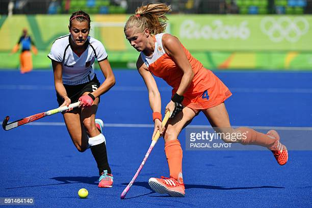 Netherlands' Kitty van Male vies with Germany's Selin Oruz during the women's semifinal field hockey Netherlands vs Germany match of the Rio 2016...