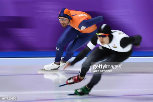 Netherlands' Kjeld Nuis and Japan's Takuro Oda compete in the men's 1500m speed skating event during the Pyeongchang 2018 Winter Olympic Games at the...