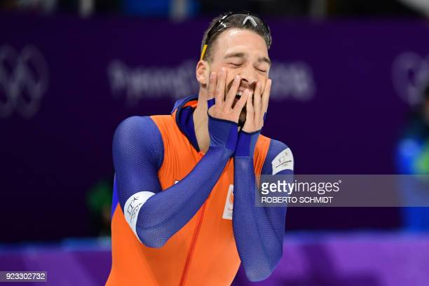 Netherlands' Kjeld Nuis celebrates his gold win in the men's 1,000m speed skating event during the Pyeongchang 2018 Winter Olympic Games at the...
