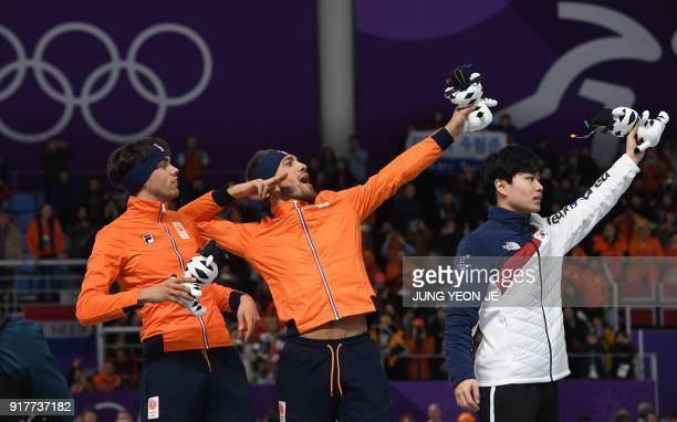 TOPSHOT Netherlands' Kjeld Nuis for gold Netherlands' Patrick Roest for silver and South Korea's Kim Min Seok for bronze celebrate on the podium...