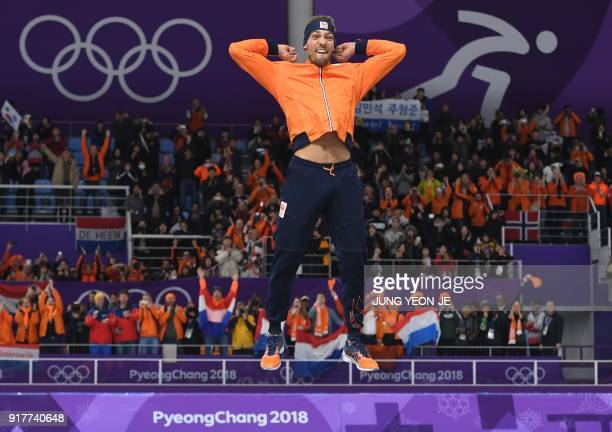 TOPSHOT Netherlands' Kjeld Nuis for goldcelebrates on the podium following the men's 1500m speed skating event during the Pyeongchang 2018 Winter...