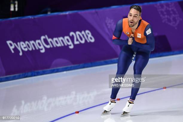 Netherlands' Kjeld Nuis reacts after the men's 1500m speed skating event during the Pyeongchang 2018 Winter Olympic Games at the Gangneung Oval in...