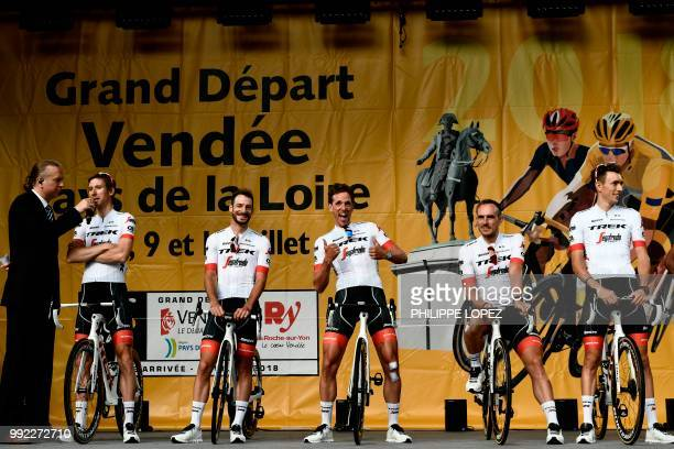 Netherlands' Koen de Kort gestures as riders of USA's Trek - Segafredo cycling team stand on stage during the team presentation ceremony on July 5,...