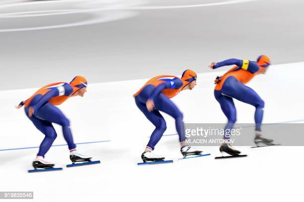 Netherlands' Koen Verweij Netherlands' Jan Blokhuijsen and Netherlands' Sven Kramer compete in the men's team pursuit quarterfinal speed skating...
