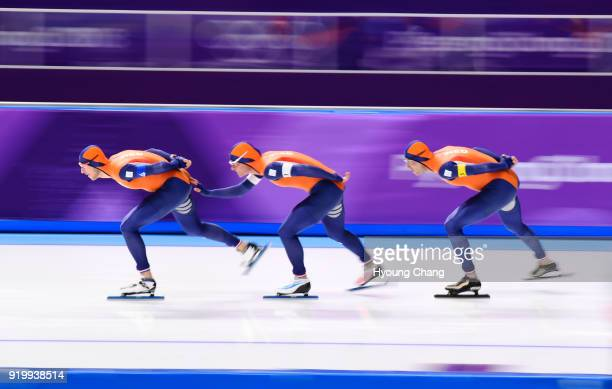 Netherlands' Koen Verweij Netherlands' Sven Kramer and Netherlands' Jan Blokhuijsencompete compete in the men's team pursuit quarterfinal speed...