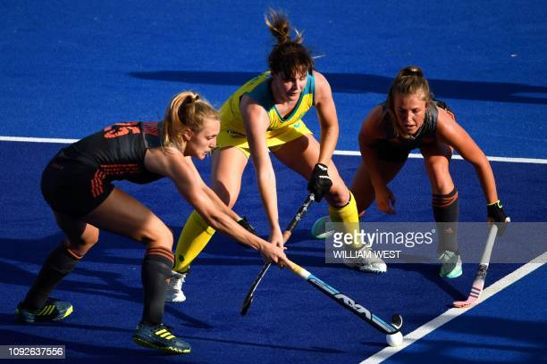 Netherlands' Kyra Fortuin and Xan de Waard tackle Australia's Lily Brazel during their FIH Pro League hockey match in Melbourne on February 2 2019 /...