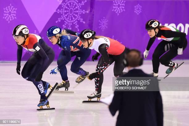 Netherlands' Lara van Ruijven Britain's Elise Christie Poland's Magdalena Warakomska and Hungary's Andrea Keszler compete in the women's 1000m short...