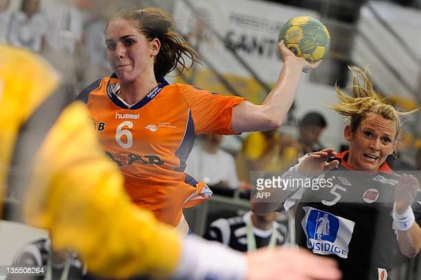 Netherlands' Laura van der Heijden throws a shot against Norway during their Women's World Handball Championship match in Santos Sao Paulo state...