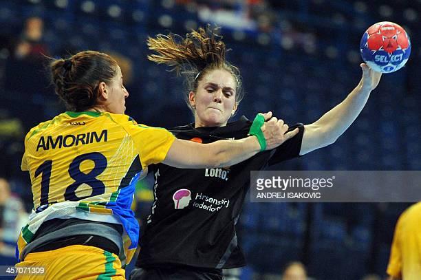 Netherland's Laura van der Heijden vies with Brazil's Eduarda Amorim during their Women's 2013 Handball World Championship round of sixteen match...