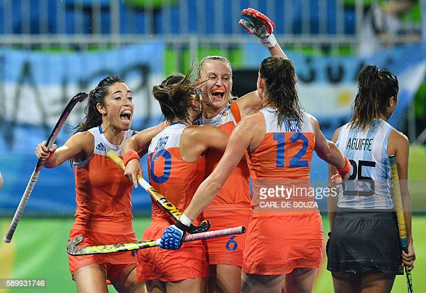 TOPSHOT Netherlands' Laurien Leurink celebrates a goal with teammates during the women's quarterfinal field hockey Netherland vs Argentina match of...