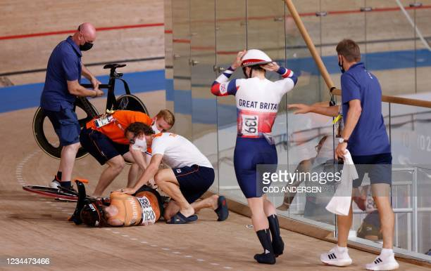 Netherlands' Laurine van Riessen received medical attention after crashing with Britain's Katy Marchant during a heat of the women's track cycling...