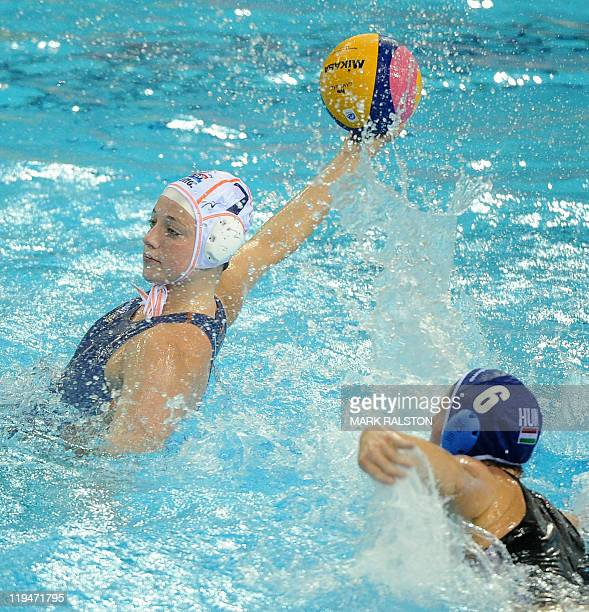 Netherlands' Lefke Van Belkum and Hungary's Orsolya Takacs compete during the women's group A water polo preliminary round match in the FINA World...