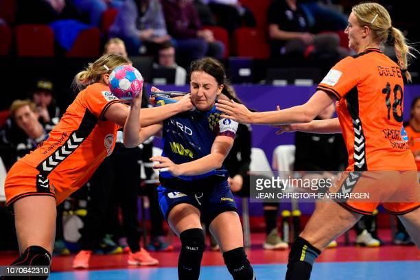 Netherlands' left back Jessy Kramer and Netherlands' left back Kelly Dulfer defends against Romania's center back Eliza Lulia Buceschi during the...