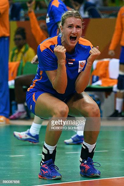 Netherlands' left back Kelly Dulfer celebrates a goal during the women's quarterfinal handball match Brazil vs Netherlands for the Rio 2016 Olympics...