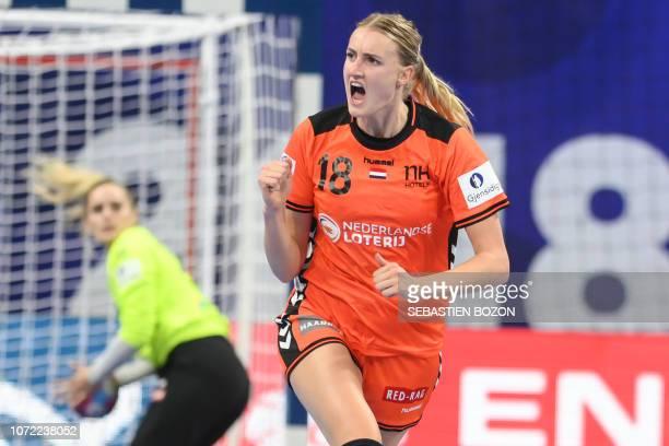 Netherlands' left back Kelly Dulfer jubilates during the 2018 European Women's handball Championships Group 2 main round match between Netherlands...
