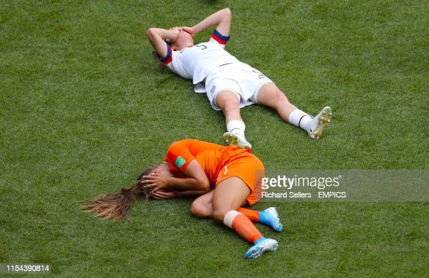 Netherlands' Lieke Martens and USA's Kelley O'Hara lie injured on the pitch after a collision USA v Netherlands FIFA Women's World Cup 2019 Final...
