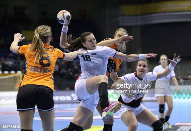 Netherlands' Lois Abbingh and Kelly Dulfer vie with Czech Republic's Iveta Luzumova and Petra Adamkova during the IHF Womens World Championship...