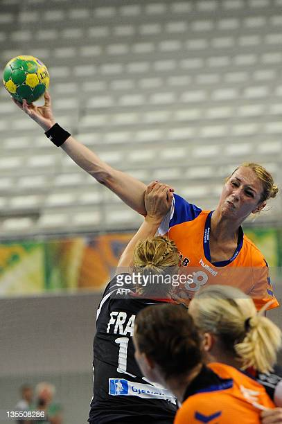 Netherlands' Lois Abbingh attempts to shoot over Norway's Malm Frafjord during their Women's World Handball Championship match in Santos Sao Paulo...