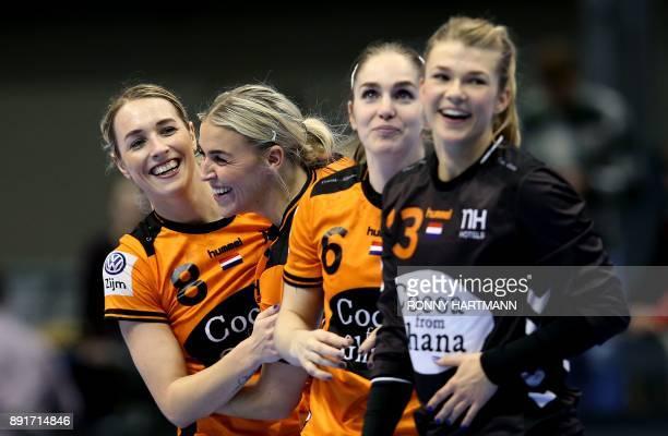 Netherlands' Lois Abbingh Jessy Kramer Laura van der Heijden and goalkeeper Tess Wester celebrate after winning the IHF Womens World Championship...