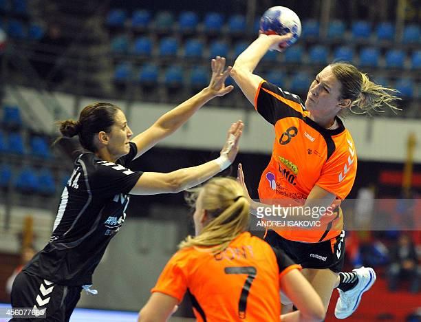 Netherlands' Lois Abbingh vies with Montenegro's Andjela Bulatovic during the women's 2013 Handball World Championship match between Montenegro and...