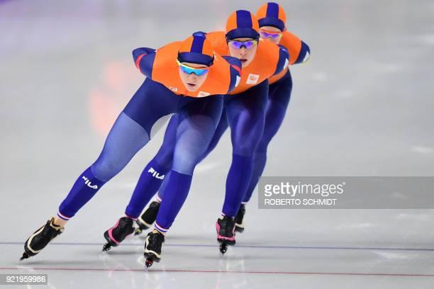 TOPSHOT Netherlands' Lotte van Beek Netherlands' Antoinette De Jong and Netherlands' Ireen Wust compete in the women's team pursuit semifinal speed...