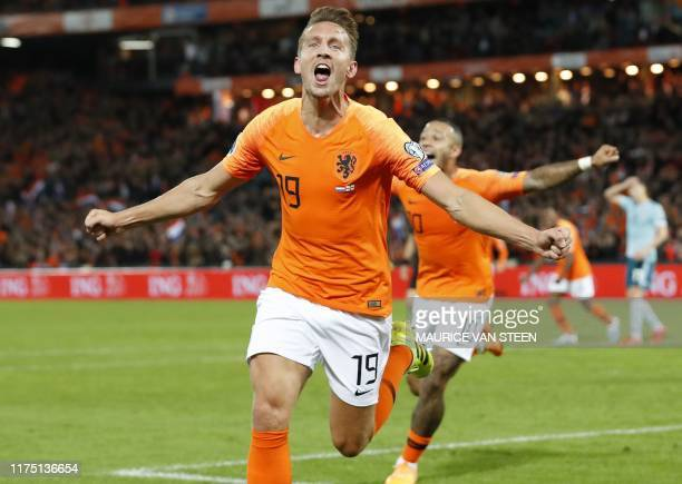 Netherlands' Luuk de Jong and Memphis Depay celebrate at the end of the UEFA Euro 2020 group C qualifying football match between the Netherlands and...