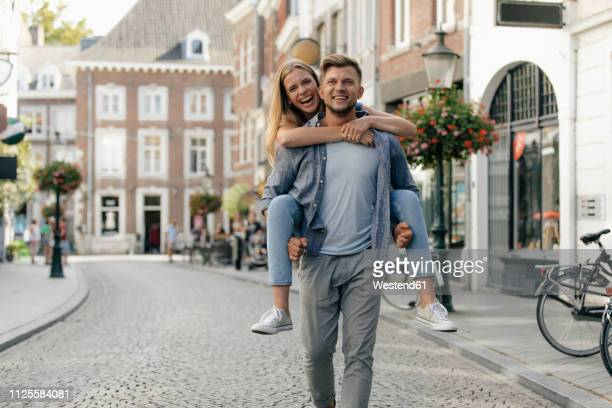 netherlands, maastricht, happy young couple in the city - マーストリヒト ストックフォトと画像