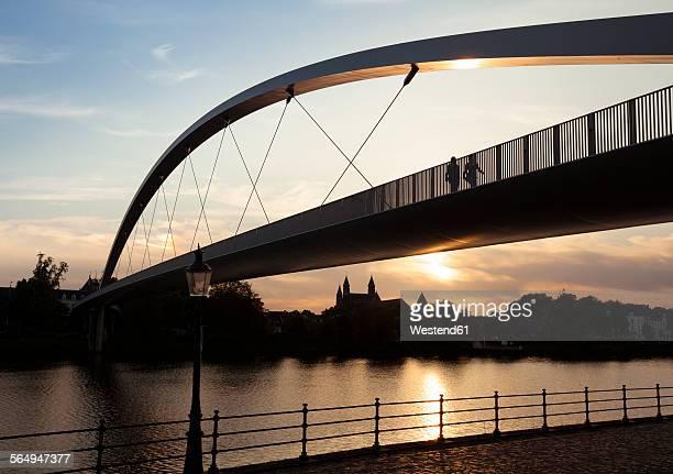 Netherlands, Maastricht, Meuse river and Hoge Brug at sunset
