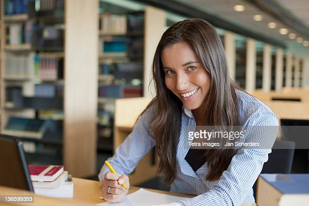 Netherlands, Maastricht, Portrait of female student studying in library