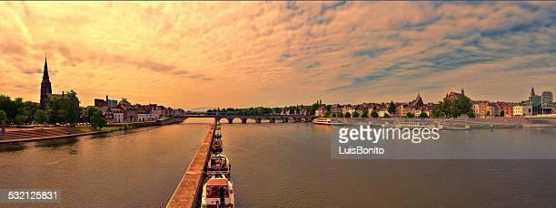netherlands, maastricht, sunset panoramic view of town with st servatius bridge - マーストリヒト ストックフォトと画像