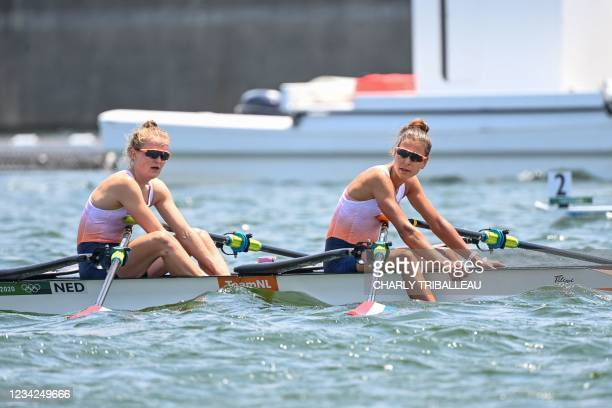 Netherlands' Marieke Keijser and Ilse Paulis react at the end of the women's lightweight double sculls semi-final during the Tokyo 2020 Olympic Games...