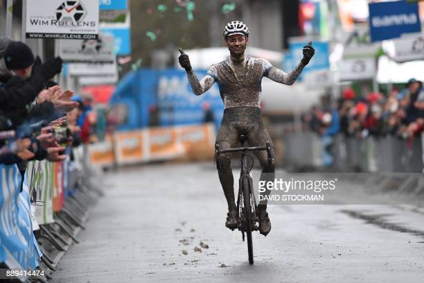TOPSHOT Netherland's Mathieu Van Der Poel celebrates after winning the men race at the Vlaamse Druivencross cyclo cross Overijse cycling race in...
