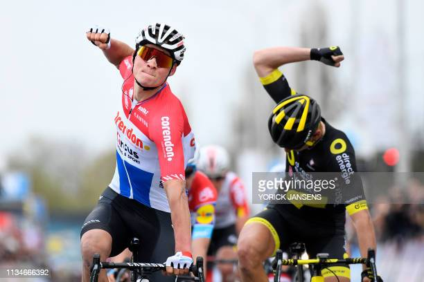 TOPSHOT Netherland's Mathieu Van der Poel of CorendonCircus celebrates as he crosses the finish line followed by France's Anthony Turgis of Direct...