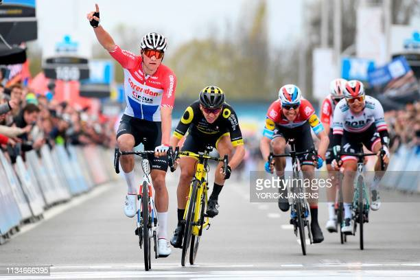 Netherland's Mathieu Van der Poel of CorendonCircus celebrates as he crosses the finish line followed by France's Anthony Turgis of Direct Energie...